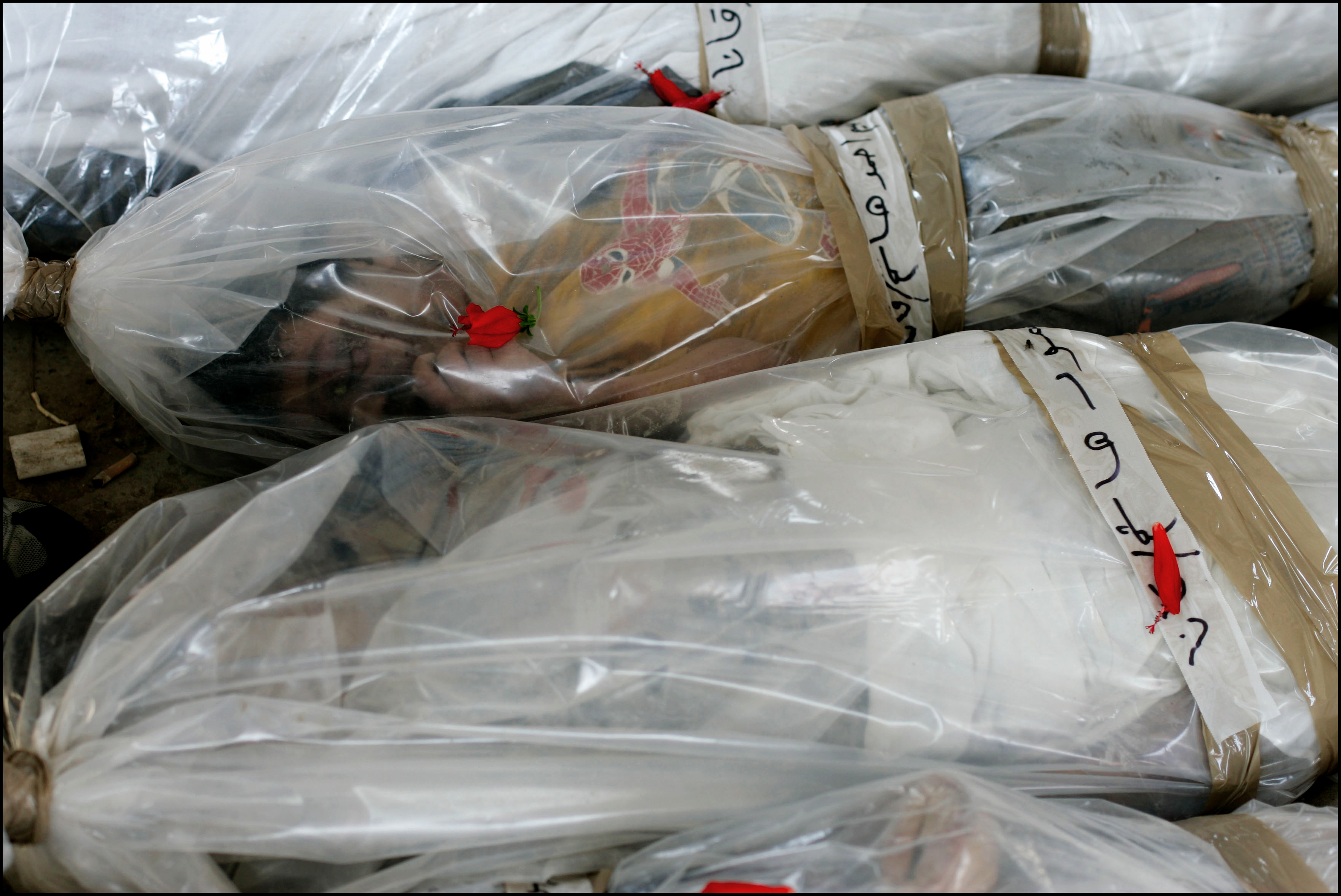 Corpses of some of the 50 civilians , mainly children, killed by israeli shelter bomb strike.