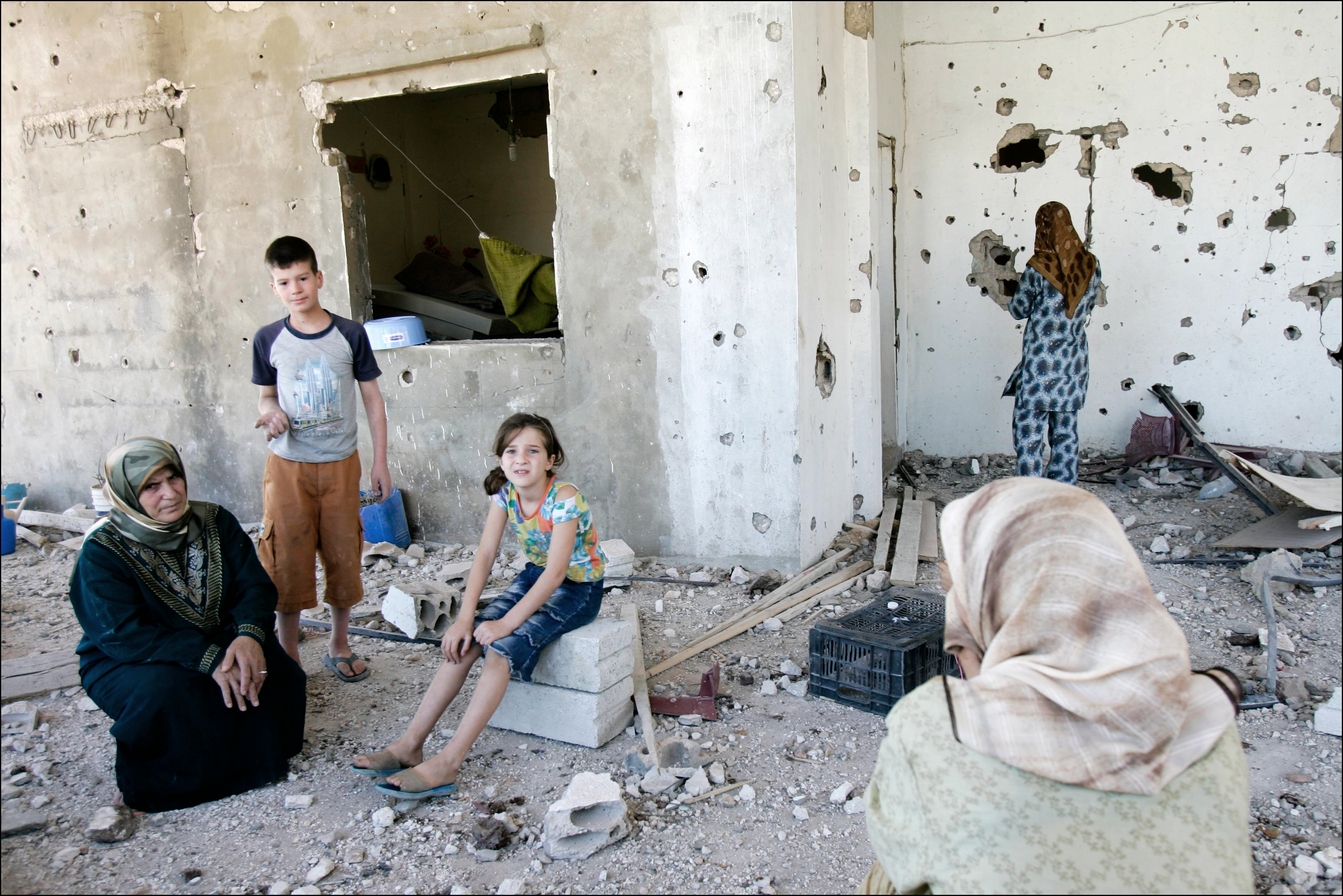 Lebanese refugees return to their home in Qana, badly damaged by heavy Irsaeli shelling, after one month of exile. Many Lebanese celebrated what they perceived as the win of Hizbollah after a month long war with Israel that lead to over 1000 civilian deaths in Lebanon and vast destruction of the country's infrastructure from heavy Israeli bombardments.