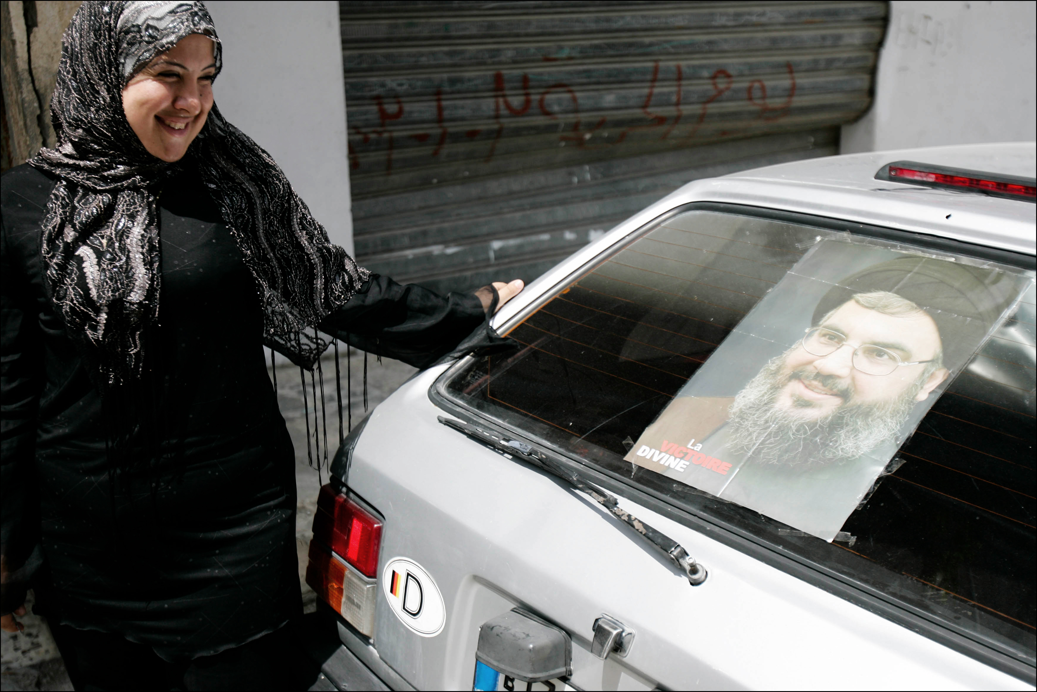 A Lebanese girl shows off a portrait of HIzbollah leader Hassan Nasrallah on her car in the southern Lebanese town of Abbasiyeh. Many Lebanese celebrated what they perceived as the win of Hizbollah after a month long war with Israel. The war lead to over 1000 civilian deaths in Lebanon and vast destruction of the country's infrastructure from heavy Israeli bombardments.
