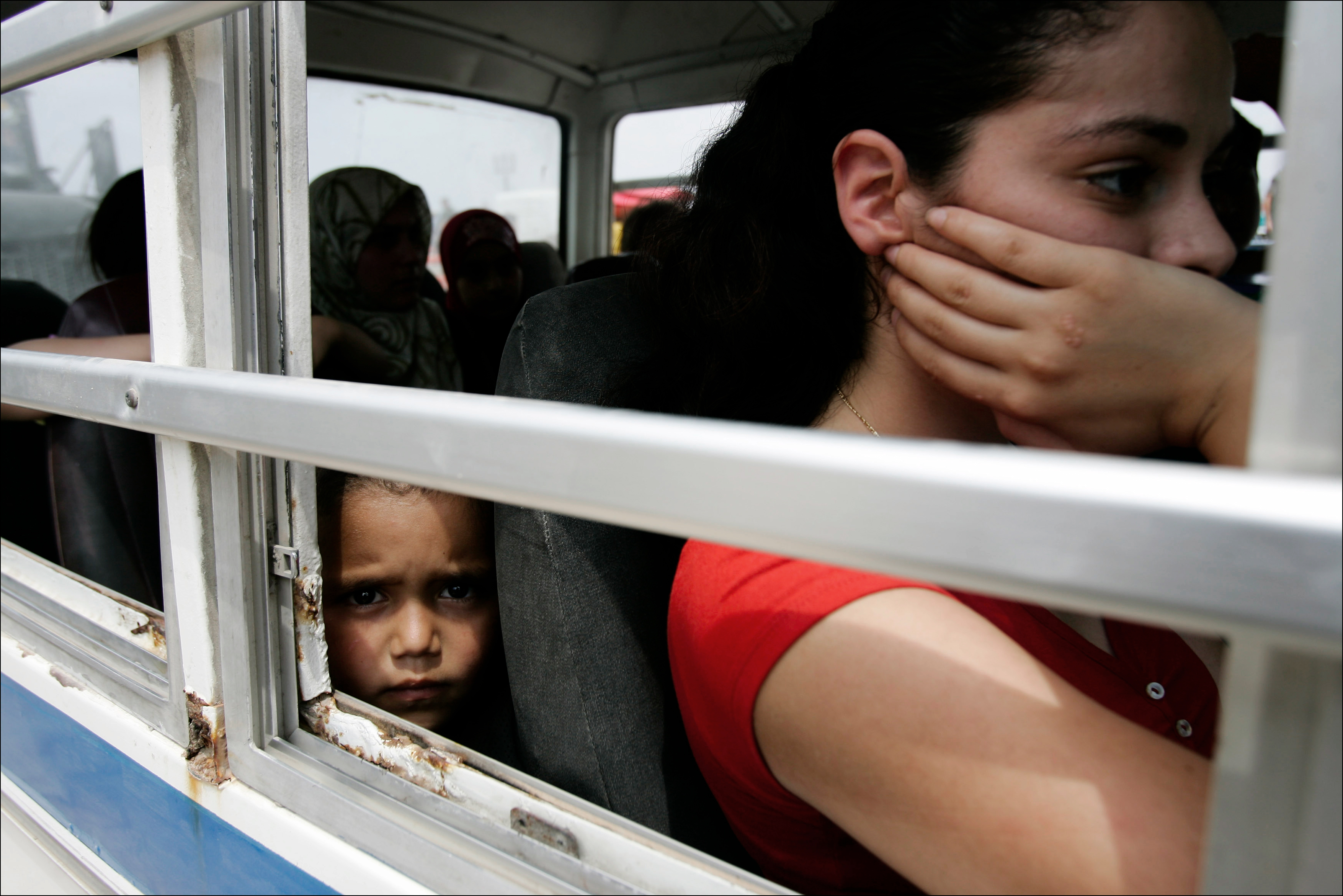 Lebanese refugees from southern Lebanon arrive at the Tyres port to be evacuated to Cyprus in a ship rented by Germany, July 24, 2006.