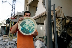 Destruction in Bint Jbeil. Many Lebanese celebrated what they perceived as the win of Hizbollah after a month long war with Israel. The war lead to over 1000 civilian deaths in Lebanon and vast destruction of the country's infrastructure from heavy Israeli bombardments.
