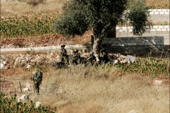 An Israeli reconnaissance team progresses through fields around the southern Lebanese town of Aitaroun, only hundreds of meters from Hizbollah fighters spotting them with binoculars. Two days after a ceasefire agreement, Israeli and Hizbollah forces on the ground near the border find themselves in uncomfortable proximity. Many Lebanese celebrated what they perceived as the win of Hizbollah after a month long war with Israel. The war lead to over 1000 civilian deaths in Lebanon and vast destruction of the country's infrastructure from heavy Israeli bombardments.