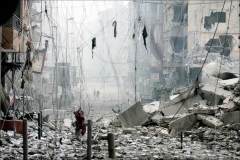 Daylight shows colossal damage after Israeli rockets rained down on Lebanon's capital. Entire apartment buildings dissapeared after Israeli vacuum bombs hit Beirut's Southern Shiite suburb of Dahiyeh incessantly for 3 straight days. The suburbs, where few survivors were found, were embedded in silence July 16, 2006.